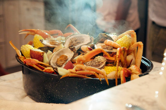 Seafood boil in a steamy pot for a festive and delicious party
