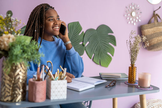Young businesswoman talking and working at home