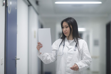 asia woman doctor checking protocol in a hospital