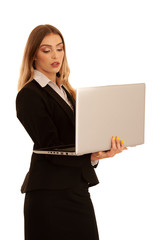 Young business woman works on laptop isolated over white