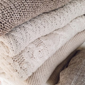 Stack Of Various Folded Woolen Fabric