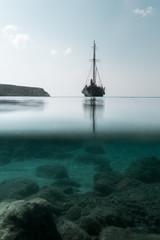 Tall Ship Sailing On Sea Against Sky