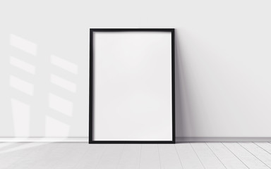 White poster with blank frame on wooden floor. Mockup for you design print.