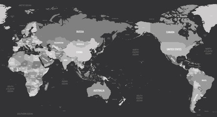 World map - Asia, Australia and Pacific Ocean centered. Grey colored on dark background. High detailed political map of World with country, capital, ocean and sea names labeling