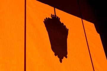 Shadow Of Street Light On Orange Awning Fotomurales