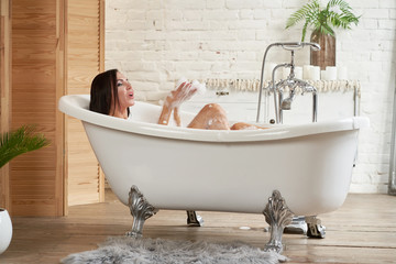 Close-up portrait of a woman relaxing in the bubble bath