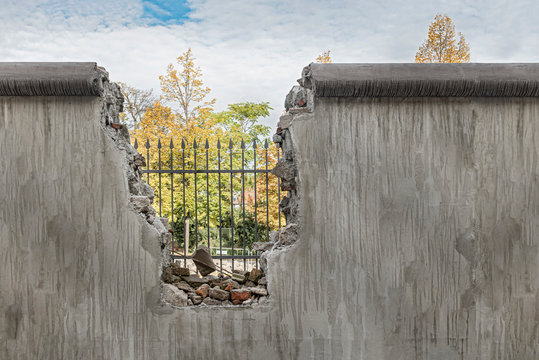 Political barricade that limits freedom. Broken wall that symbolizes freedom