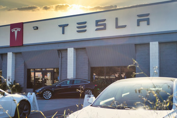 Burbank, California / USA - 01/24/2020: Outside the Tesla showroom and service center under the late day sun, with cars waiting for service.