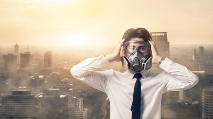 Fototapeta Portrait business man with gas mask he serious problem dust smog in the city, People appeal industry environmental concern with cloud pm 2.5  M obraz