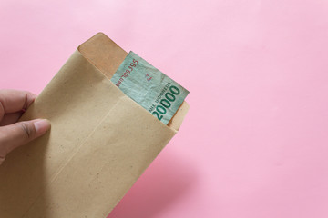 Money or Indonesia Rupiah in envelope. Saving concept. Salary concept.