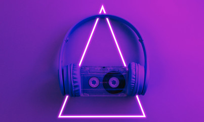 Headphones with audio cassette. 80's synth wave and retrowave glowing triangle futuristic aesthetics. Old fashioned abstraction concept