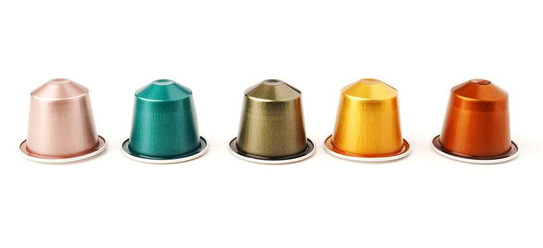 Colorful espresso coffee capsules on white background