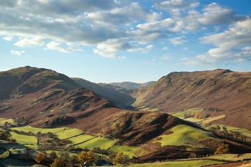 Poster Cappuccino Majestic Autumn Fall landscape image of Sleet Fell and Howstead Brow in Lake District with beautiful early morning light in valleys and on hills