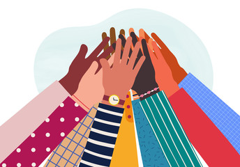 Hands of diverse group of people together raised up. Concept of support and cooperation, friendship.