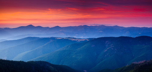 Wall Mural - Calm evening landscape in the mountains at sunset.
