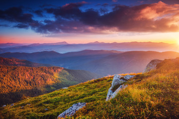 Wall Mural - Perfect evening landscape in the mountains at sunset. Colorful cloudy sky.