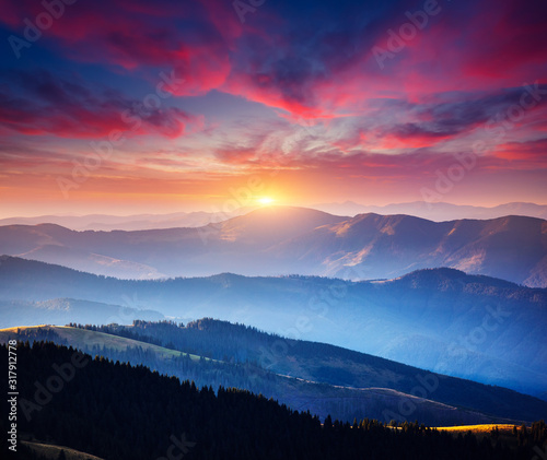 Wall mural Incredible landscape in the mountains at sunset.