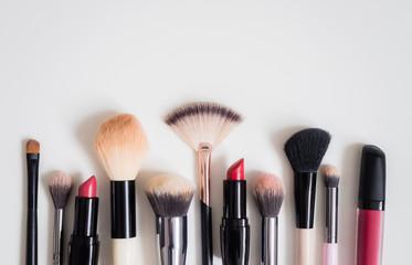 Make up concept: Professional makeup tools and accessories. Lipstick, mascara, nail polish, eyeshadow, powder, eyelash and foundation. Top view.