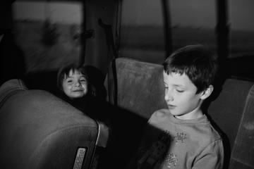 Cute Siblings In Bus
