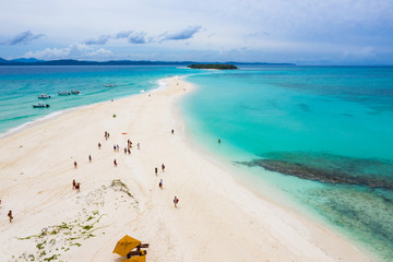 Visitors on the Sandy Tongue in Turquoise Waters of Nosy Iranja, Madagascar