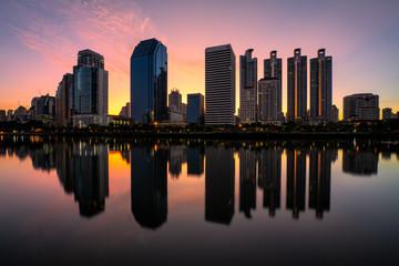 Poster Bangkok Bangkok metropolitan cityscape with sunrise and water reflection
