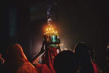 Rear View Of Women Celebrating Traditional Festival At Night