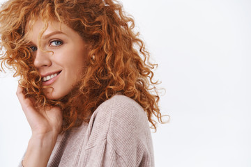 Close-up portrait beautiful, sensual gorgeous woman with curly natural red hair, standing...