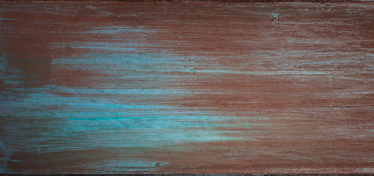 The texture of the copper background is covered with a patina