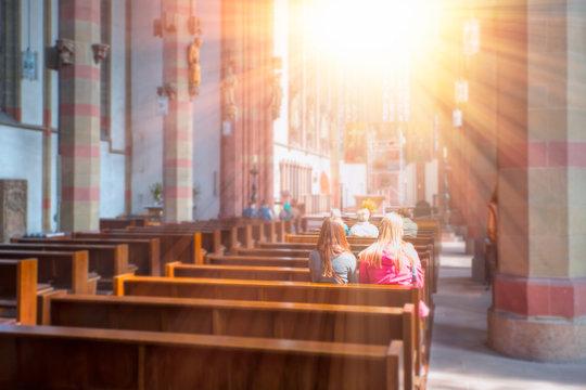 People praying in a church