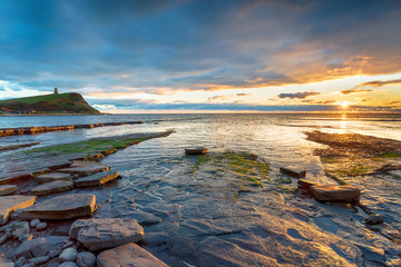 Wall Mural - Beautiful sunset over the bay at Kimmeridge near Wareham on the Dorset coast