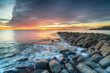 Sunset over Clavell Pier in Dorset