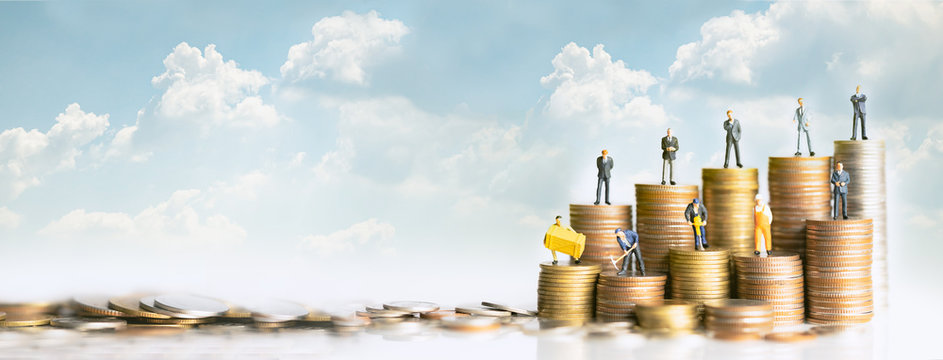 Miniature people standing on stack of coins. Inequality and social class. Income and economic inequality concept. Inequality in social class, ideology, Gender, Racial and ethnic and health.
