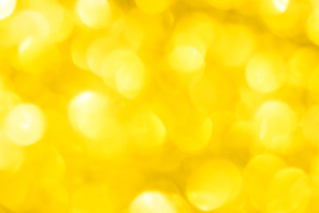 Golden glitter festive background with bokeh lights. Celebration concept for New Year, Christmas...