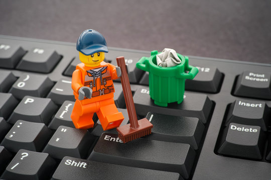 Tambov, Russian Federation - January 24, 2020 Lego minifigure cleaning keyboard with a broom.