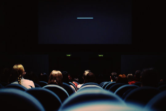 GROUP OF PEOPLE in auditorium