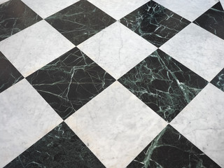 chequered white green and black stone floor background Wall mural