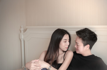 Asian lesbian couple cuddle and look at each other with love. Copy space, Natural light Wall mural