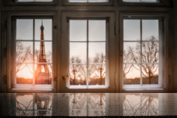 Wall Mural - Wooden desk of free space for your decoration.Blurred retro old window with city landscape of Paris. Valentine's Day background and copy space.