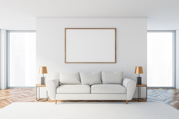 White living room with white sofa and poster