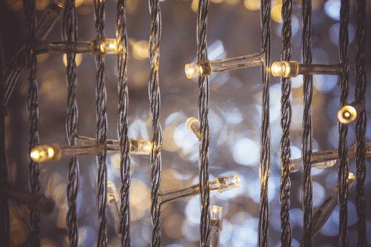 Full Frame Of Illuminated Light Bulbs Hanging At Night