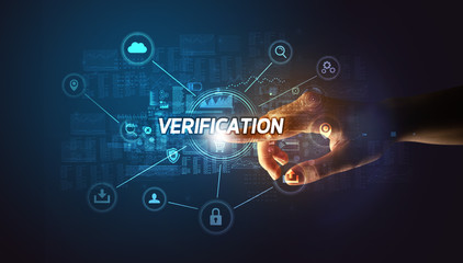 Hand touching VERIFICATION inscription, Cybersecurity concept