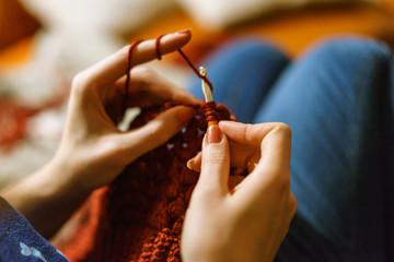 Cropped Image Of Woman Knitting Wool
