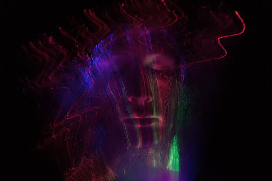 Digital Composite Image Of Man With Light Painting Against Black Background