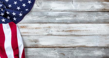 Waving United States Flag on white rustic wood Background