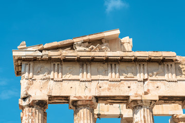 Fototapete - Parthenon temple close-up, Athens, Greece. It is top landmark of Athens. Detail of facade with old relief. Ancient Greek ruins on sky background.