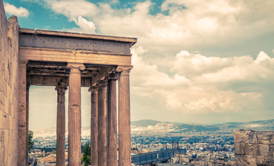 Fototapete - Athens view from Acropolis, Greece. Columns of Erechtheion temple overlooking Athens city. Acropolis hill is top landmark of Athens. Scenery of Ancient Greek ruins.