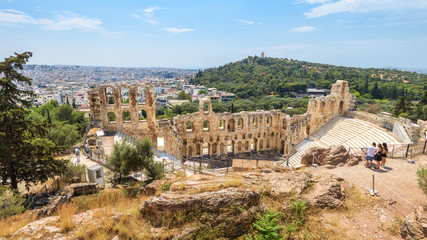 Fototapete - Odeon of Herodes Atticus at Acropolis of Athens, Greece. It is famous landmark of Athens. Panoramic scenic view of ancient theater overlooking Athens city.