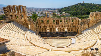 Fototapete - Odeon of Herodes Atticus at Acropolis of Athens, Greece. It is one of top landmarks of Athens. Panoramic view of ancient theater overlooking Athens city.