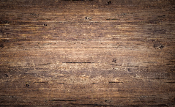 Wood texture background. Rough vintage wooden table, brown timber for backdrop, top view