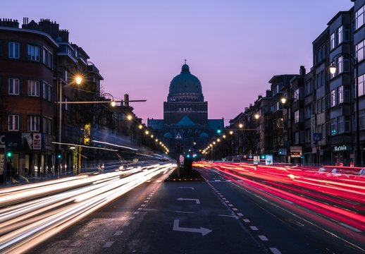 Light Trails On Street In Front Of Basilica Of The Sacred Heart At Dusk